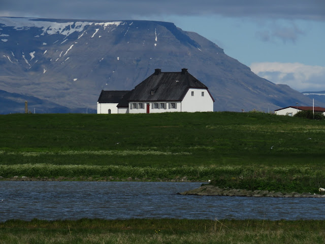 White house on the Seltjarnarnes Peninsula in Reykjavik Iceland