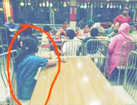 Look at this heart touching photo of maid who was made to sit separately from employers and watch them eat in a restaurant.