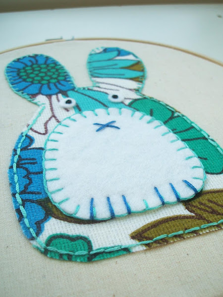 close up detail of embroidery stitches on my vintage fabric applique rabbit hoop art