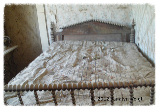 Bed with coverlet at Bodie, California