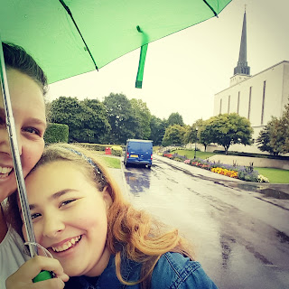 PippaD and Top Ender at the London LDS Temple in the Rain