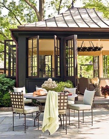 Good  smaller size of the space and the fact that the color scheme of the bluestone and house work well with the dark color of the dining chairs and table