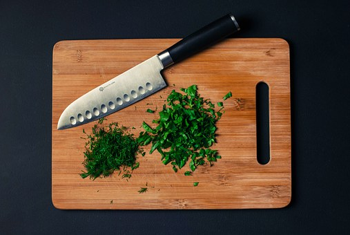 chopping board with diced herbs