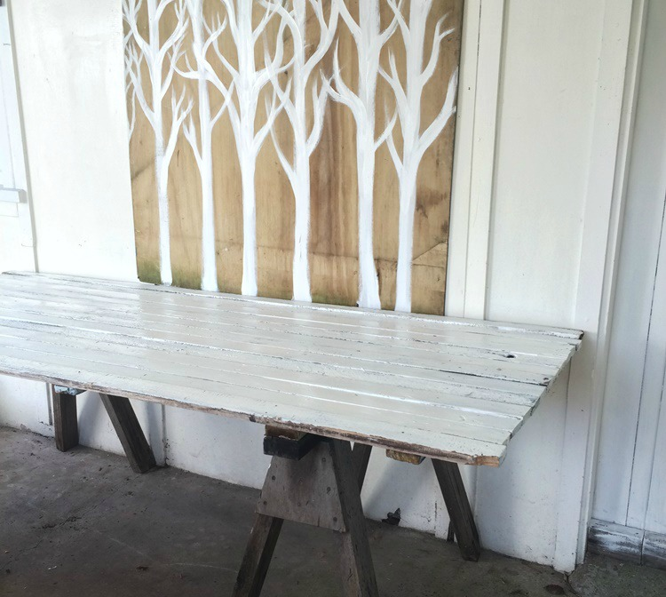 Woodland Party - homemade rustic trestle table and woodland trees backdrop