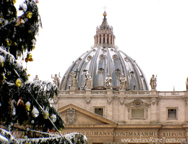 Christmas at St. Peter's in Rome, Italy, with Michelangelo's Cupola rising majestically in the background. Photo:  ARoadRetraveled.com. Unauthorized use is prohibited.