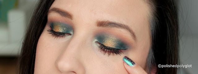 Edgy Makeup look in petrol blue and brass colours