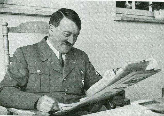 Adolf Hitler reading newspaper worldwartwodaily.filminspector.com