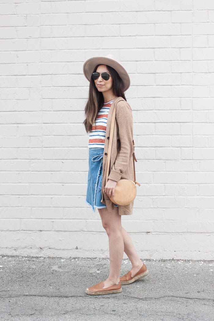 long tan cardigan, striped tee, short jean skirt, tan cantina purse