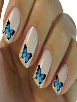 decoracion de uñas con mariposas azules