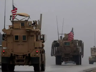 US official says troop withdrawal from Syria has began