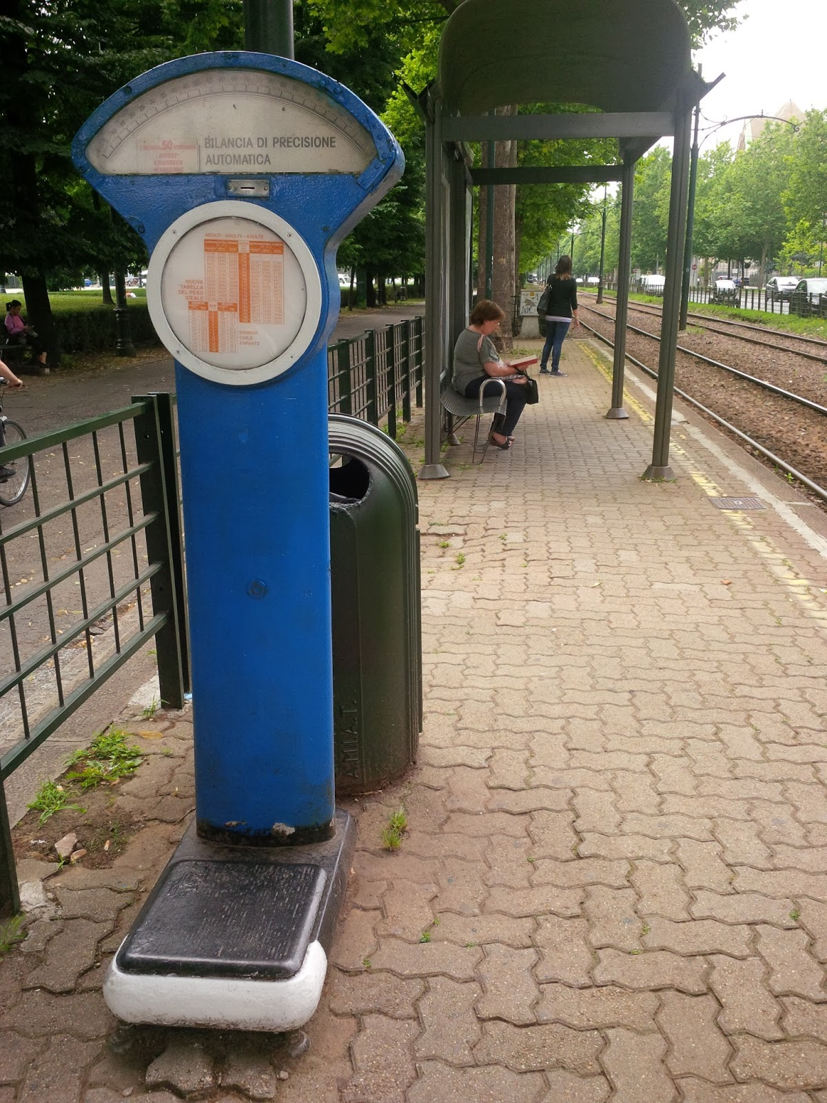 Scales on a public transport stop, Turin, Italy