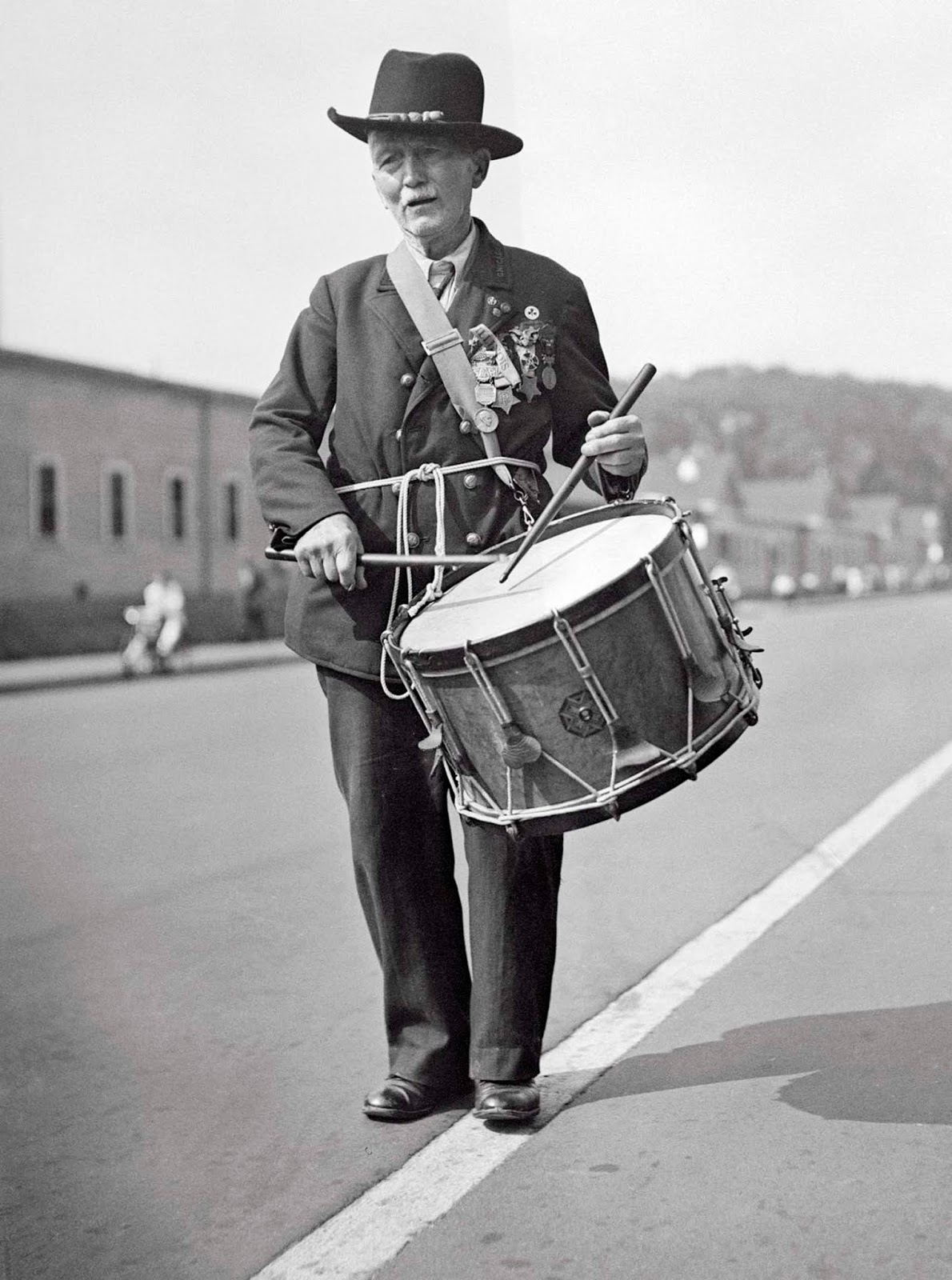 Washington, D.C. - Captain R.D. Parker, age 90, who played a drum at Lincoln's inauguration, as he took part in the final parade of the Grand Army of the Republic in Washington, D.C., closing the 70th annual encampment. The Grand Army of the Republic was an organization founded in 1866 for veterans of the Civil War. 1936.