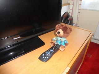 Tom watching TV