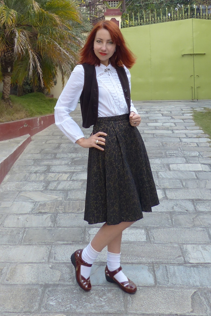 Brown skirt with white blouse and brown waistcoat