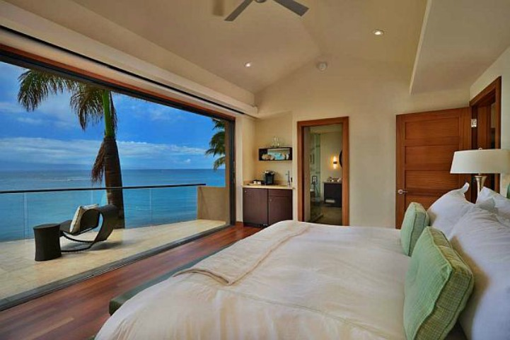 Clean coastal bedroom with ocean view