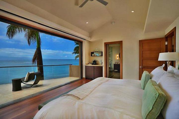 Clean coastal bedroom with ocean view