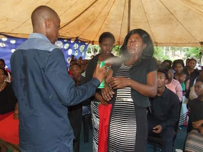 PROPHET OF DOOM' SPRAYS INSECTICIDES ON CONGREGANTS FOR HEALING.