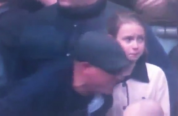 A young Millwall supporter is seen crying amongst the Wembley violence