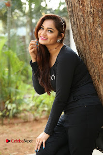 Actress Aswini Latest Stills in Black Denim Jeans  0054.JPG