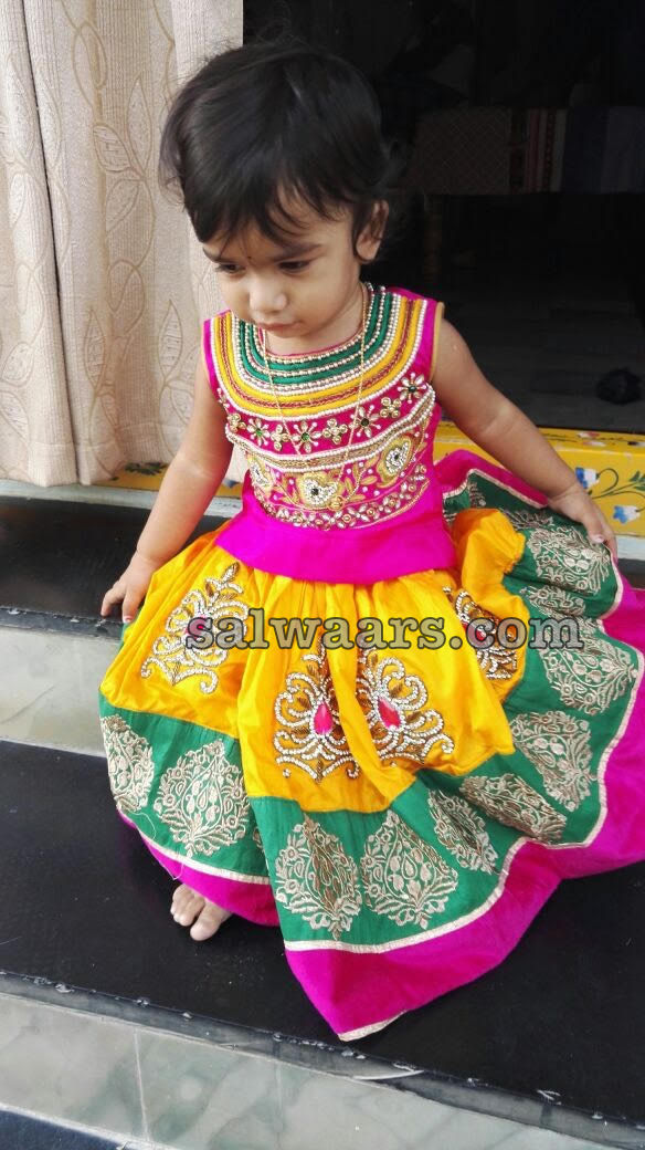 Baby in Yellow Kanchipattu Lehenga