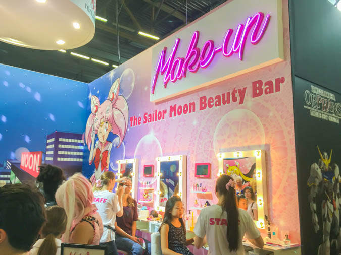 Makeup being done on visitors at the Sailor Moon booth at Japan Expo 2016