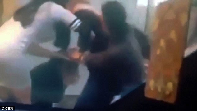 Angry women beat up couple kissing in public