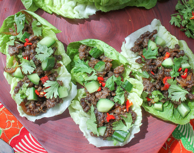 Food Lust People Love: Spicy beef lettuce cups make a great main course but they'd also be fun as appetizers. Put the lettuce leaves and spicy beef in the middle of the party table and let family and friends help themselves.