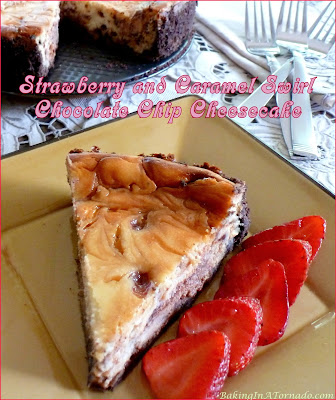 Strawberry and Caramel Swirl Chocolate Chip Cheesecake is a simple chocolate chip cheesecake swirled with layers of strawberry and caramel, then baked in a chocolate graham cracker crust. | Recipe developed by www.BakingInATornado.com | #recipe #bake #dessert