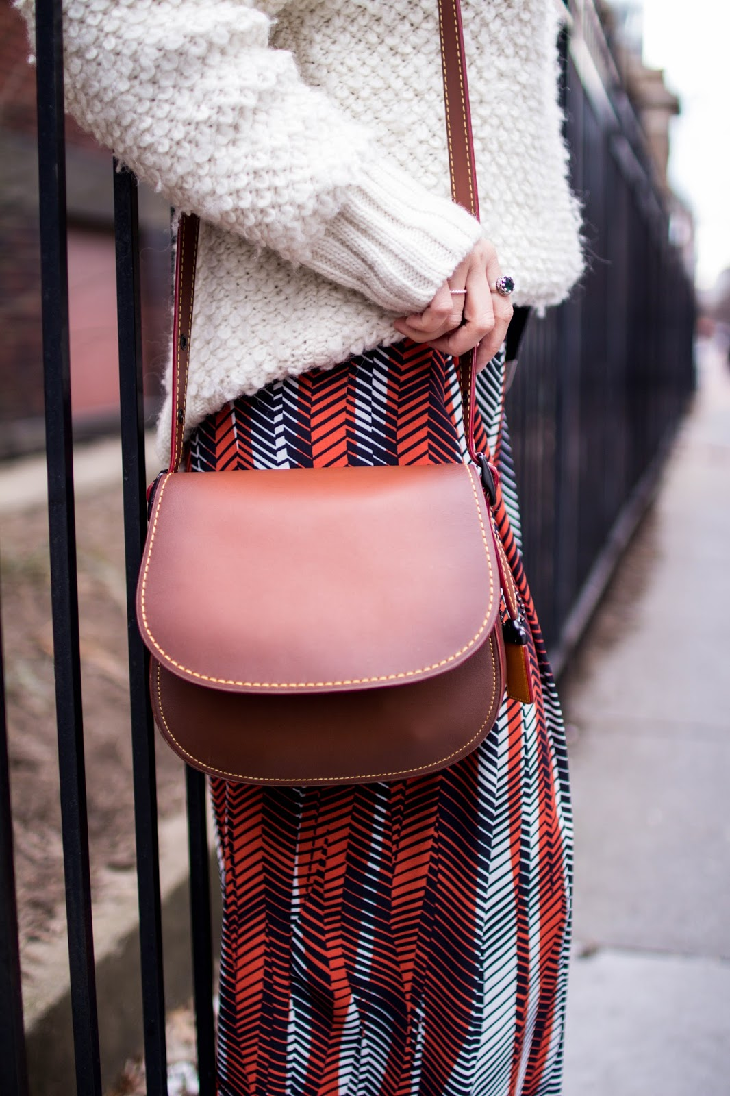 oversized wool sweater. printed pants. dc blogger. coach saddle bag
