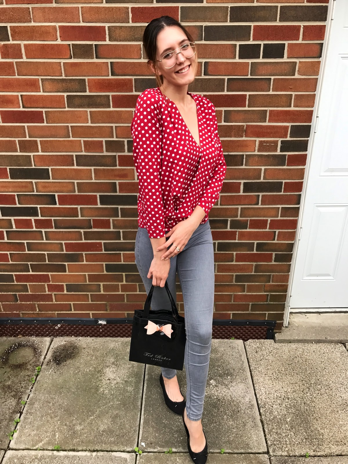 Red blouse with white polka dots