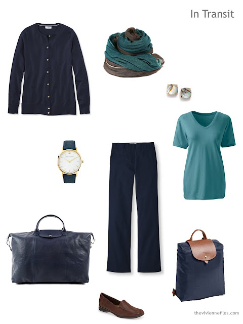 warm weather travel outfit in navy and teal with brown leather accents