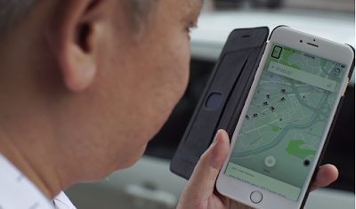 Source: Uber. Man looking at the Uber app.