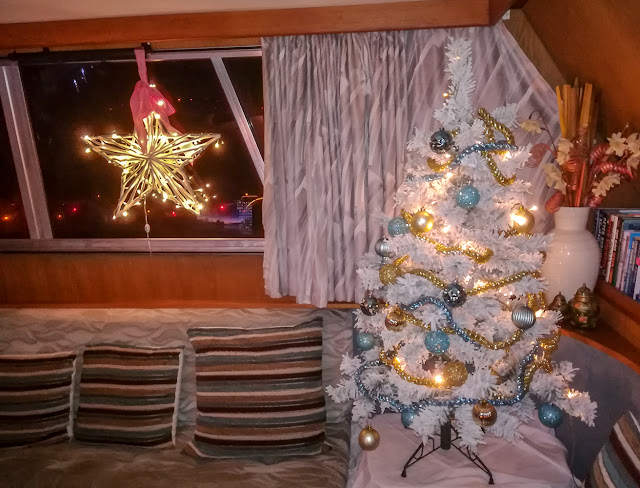 Photo of Ravensdale's Christmas tree in the corner of the saloon seating