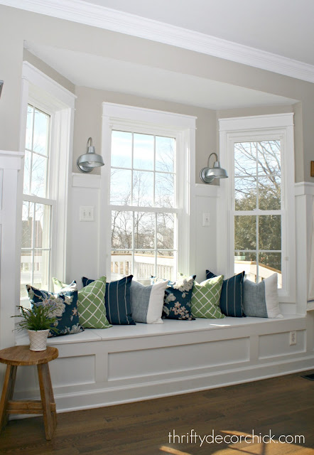 Kitchen window seat with pillows and sconces