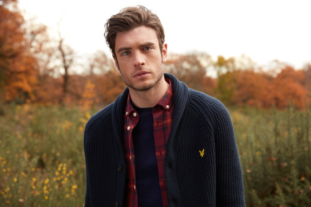 Man Layering A Check Shirt With A Cardigan
