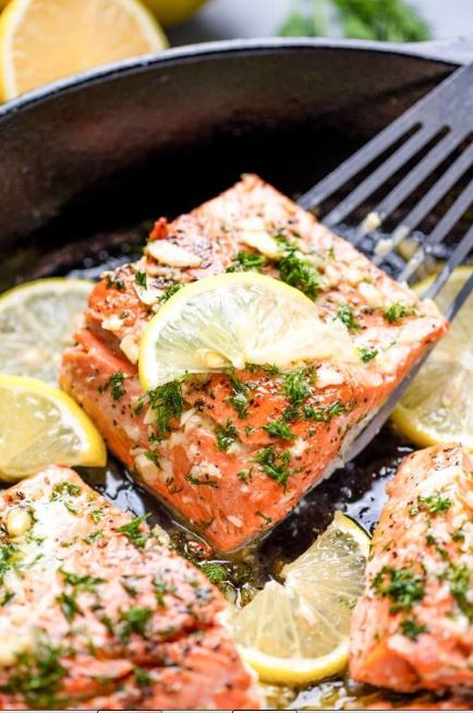 This Healthy Lemon Garlic Salmon is easy to make and ready in under 15 minutes. It's healthy, low calorie, and only uses a handful of ingredients!