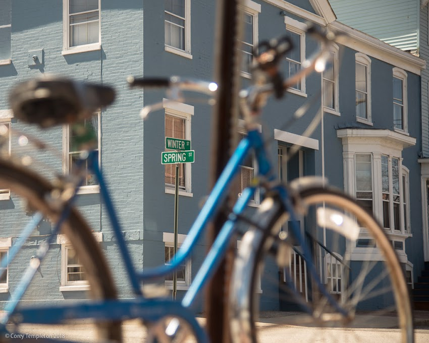 Portland, Maine USA April 2018 photo by Corey Templeton. Step Through bicycle to Winter and Spring Street signs in the West End.