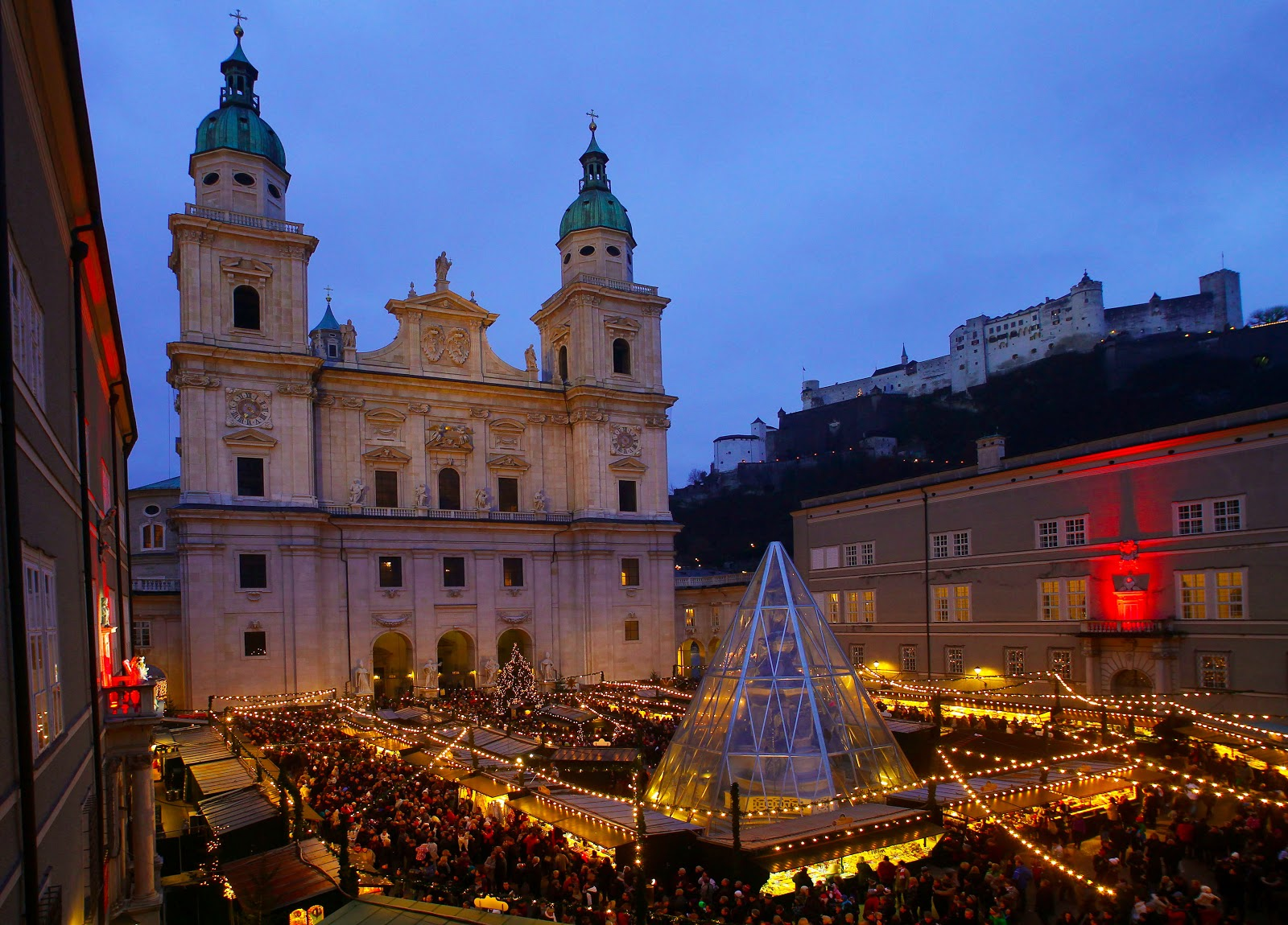 The Salzburg Christmas market at the Domplatz or Church Square twinkles beneath the imposing Hohensalzburg Castle. Photo: Courtesy of Christkindlmarkt.co.at. Unauthorized use is prohibited.