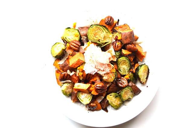 Orange Glazed Brussels Sprouts and Sweet Potatoes are a perfect mix of sweet and savory that would be a great healthier side dish for any holiday party! www.nutritionistreviews.com