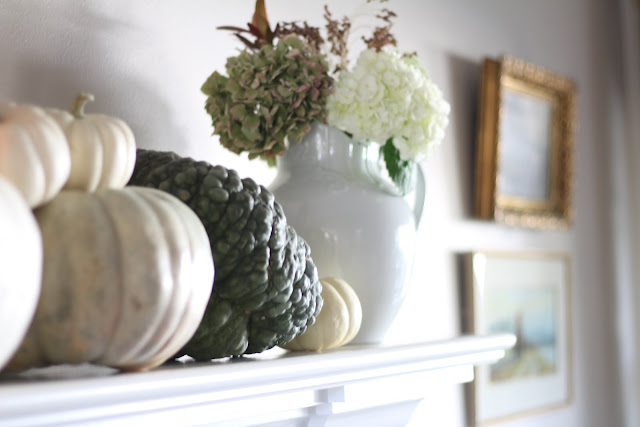 neutral fall decor mantel white and green pumpkins and hydrangeas
