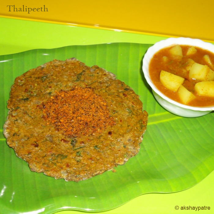 shallow fry thalipeeth and serve hot