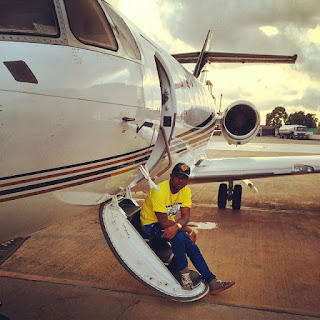 Davido pose in private jet
