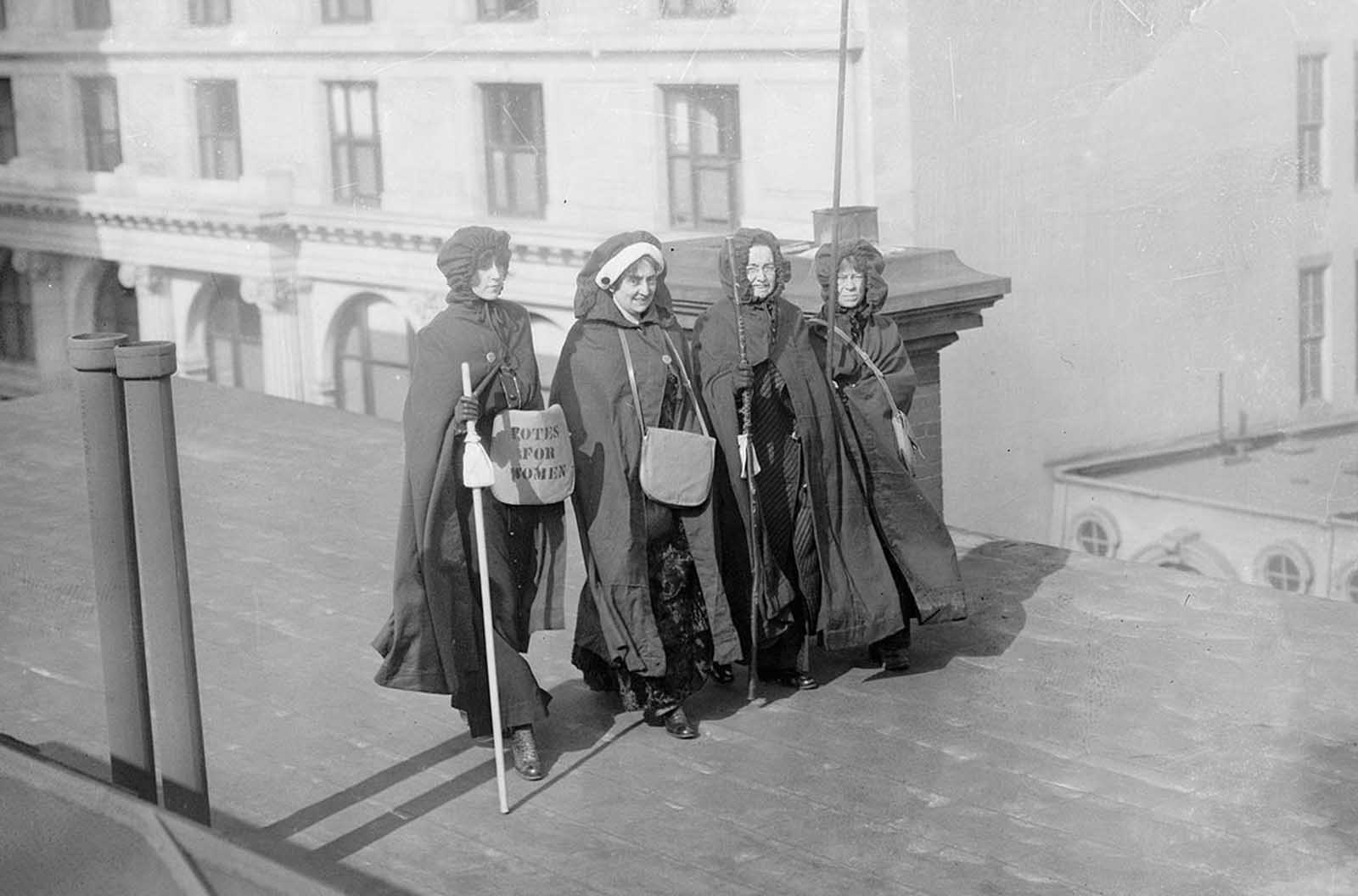 After the Parade: Mrs. John Boldt, Mrs. May Morgan, Miss Dock, and Miss Craft, suffrage hikers who took part in the suffrage hike from New York City to Washington, District of Columbia, as well as the parade itself, on March 3, 1913.