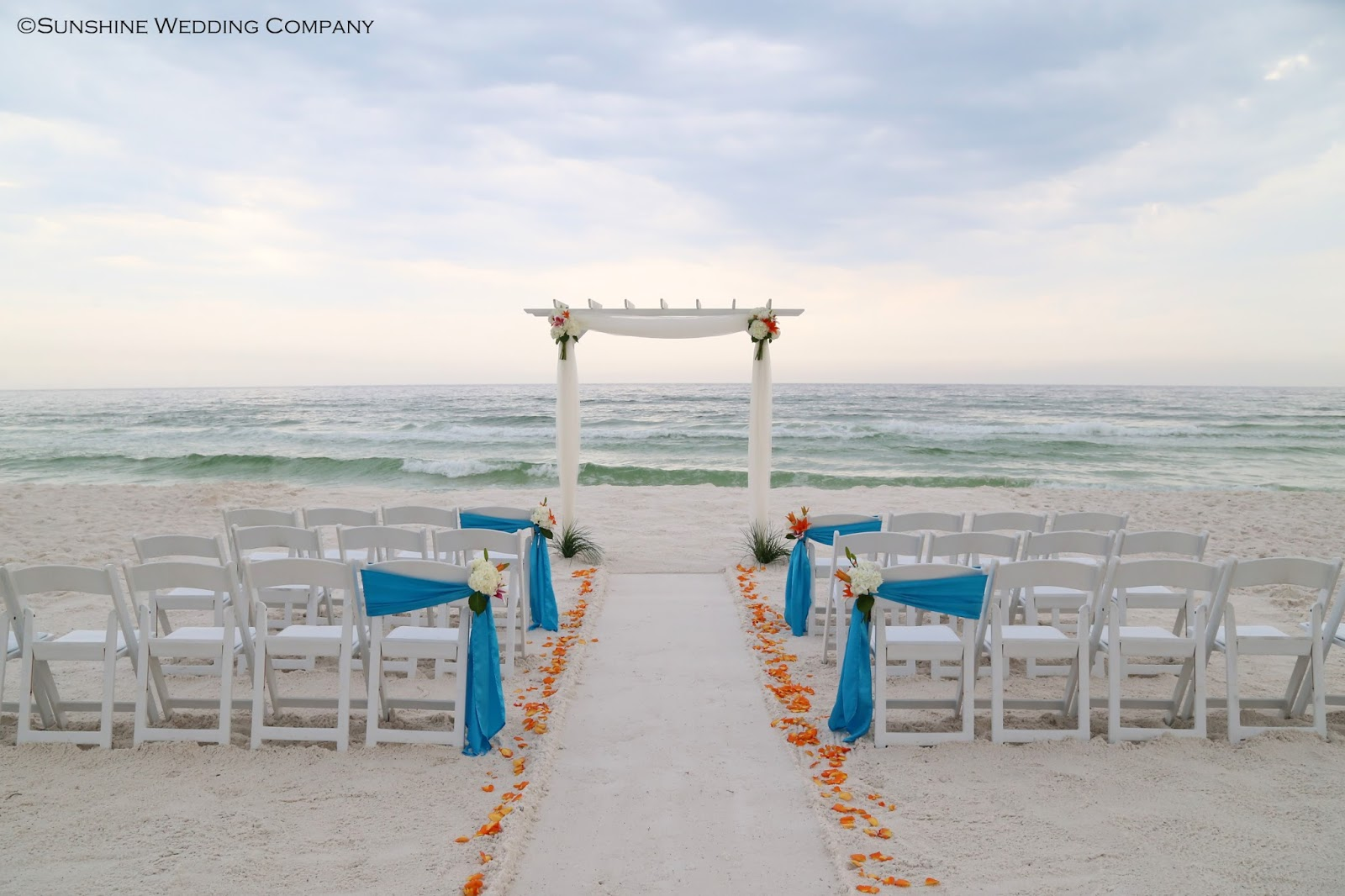 Fresh Flower Beach Wedding Decorations Malibu Blue Sashes And Orange Flowers For Your Destin