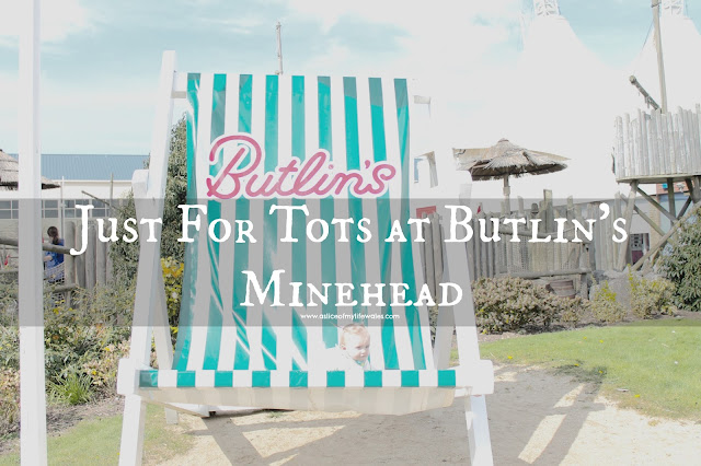 Blog review of Butlin's Just For Tots break at Minehead - baby sat in giant green and white striped butlins deck chair