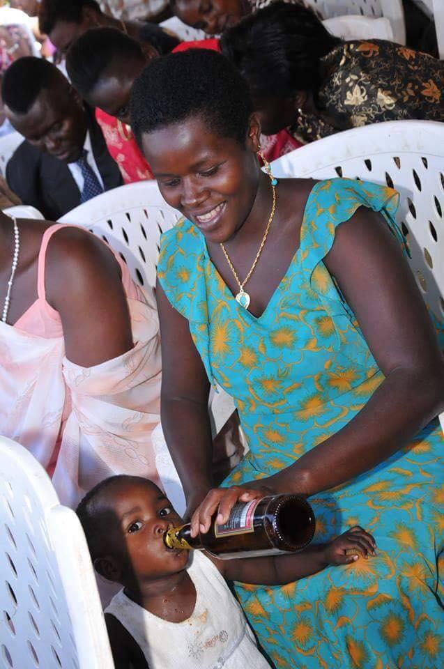 Ugandan mum pictured feeding her toddler beer