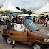 Photos: Man showcases car made from 'local wood' at Abuja Expo