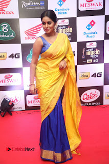 Actress Poorna Pictures in Yellow Saree at Mirchi Music Awards South 2015  0091.JPG