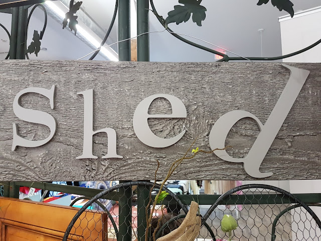 shed wooden sign the Camellia thunder bay