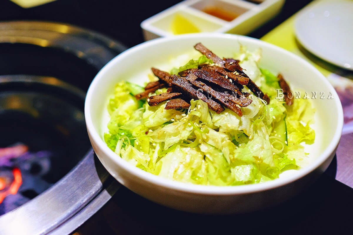 Gyu Tan Salad - fresh chopped lettuce salad with spicy beef tongue drizzled lightly with its secret dressing